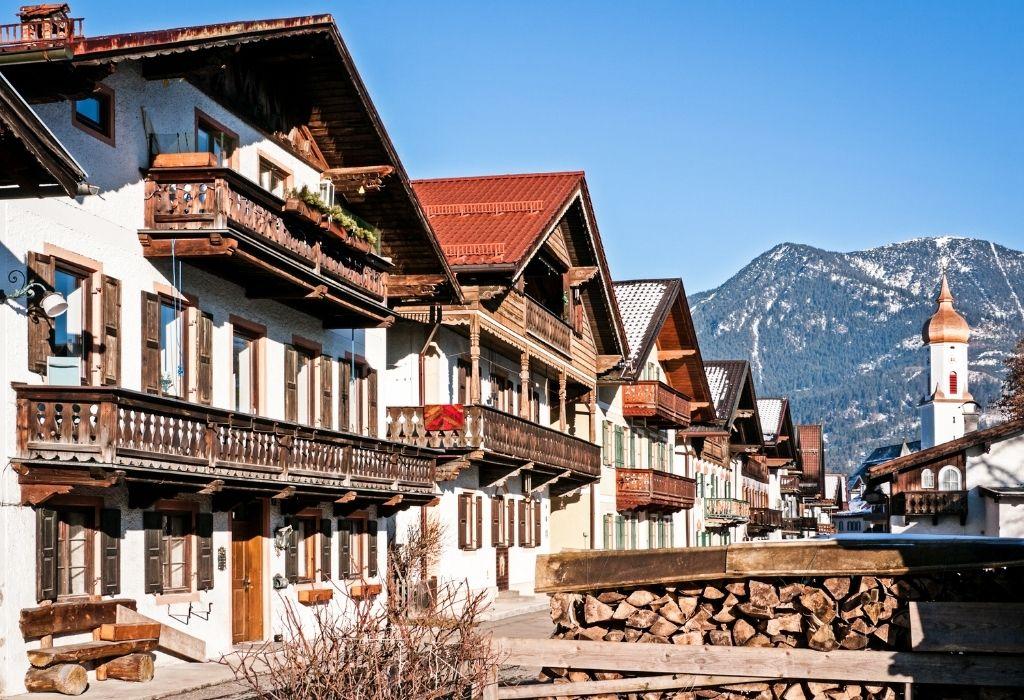 Traditional Bavarian Houses white with dark wood trim and balconies and shutters in  Garmisch Partenkirchen Bavaria